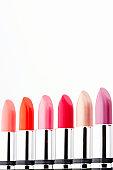 Row of assorted coloured lipsticks, close-up
