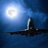 jumbo jet airplane landing at night