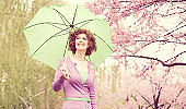 Aged Woman with Umbrella