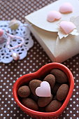 Almond chocolate in heart shape container