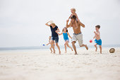 Family running together on beach