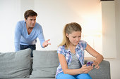 Daughter ignoring father to use cell phone