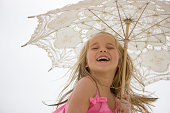 Young girl holding parasol