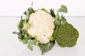 cauliflower and broccoli against white background