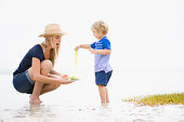 Mother playing with son on beach