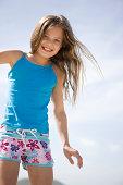 Girl on beach, smiling