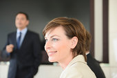 Businesswoman in meeting, smiling
