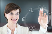 Businesswoman using touch screen