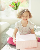 Young girl holding box, portrait
