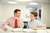 Teenage boy and businessman in office
