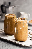 Two Iced Coffees in Mason Jars on Tray