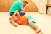 difficult parenting concept - crying child, tired father