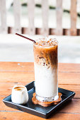 Iced coffee latte with espresso shot in white jar