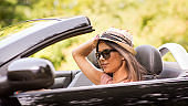 Beautiful woman driving convertible