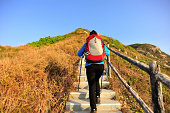woman hiking on mountain stairs