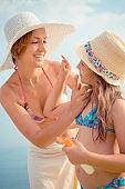 Applying sunscreen on the beach
