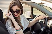 beautiful smiling woman driving car
