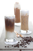 Three Ice coffee and coffee beans on a table