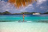 woman paddling on stand up paddle board, St.John, USVI