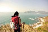 hiking woman seaside moutain peak enjoy the view