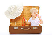Travel, children, vacation - concept. Cute funny baby playing in