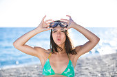 Woman on beach vacation having fun with snorkeling mask,enjoying