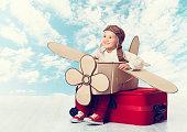 Little Child Playing Airplane Pilot, Kid Traveler on Travel Suitcase