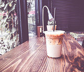 Vintage filter :Ice coffee on wood table in coffee