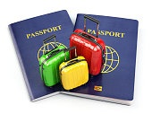 Travel or tourism concept. Passport and suitcases isolated on wh