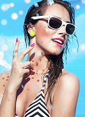Colorful summer portrait of young attractive happy brunette woman