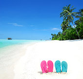 Colored flip-flops at the tropical beach