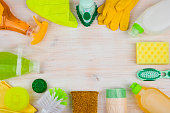 Cleaning and housework concept on wooden background, copyspace in center
