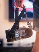 Man Holding Virtual Reality Headset