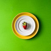 Strawberry on plate setup.