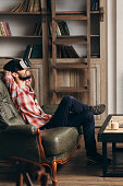 Young bearded man enjoying virtual reality glasses