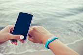 Female hands receive data from smart bracelet