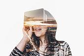 Double exposure of woman wearing virtual reality simulator