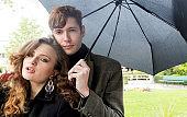 Beautiful couple in the rain under umbrella, Paris, France