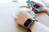 Cup of coffee, watch and mobile phone