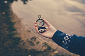 Teenager girl  holding an old compass in hand