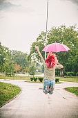 happy young woman jumping with umbrella