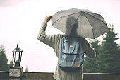 Man holding umbrella  in nature.