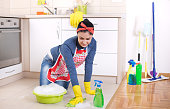 Woman cleaning kitchen floor
