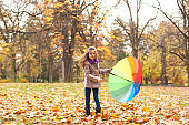 Little girl spinning with umbrella
