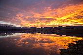Spectacular mountain lake landscape, sky on fire
