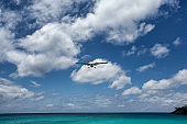 Small Commercial Plane Landing Over Beach