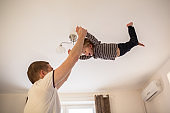 Dad plays with Toddler boy,  real interior, fatherhood