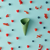 Ice cream cone with forest fruit pattern. Flat lay. Summer concept.