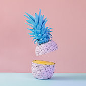 Pink pineapple on yellow background. Minimal style. Food concept