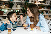 Mother and son in a cafe
